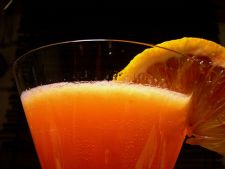 Cocktail de Bourbon si portocale rosii