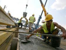 Marea Britanie tanjeste dupa muncitorii romani