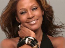 Whitney Houston a murit