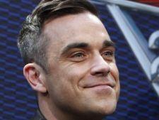 Afla ce cadou a cumparat Robbie Williams pentru fiica nenascuta!