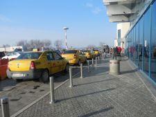 Taximetristii, nemultumiti de noile reguli impuse pe Aeroportul Henri Coanda