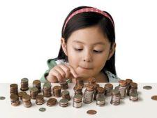 Cum ii explici copilului importanta banilor: 5 ponturi utile