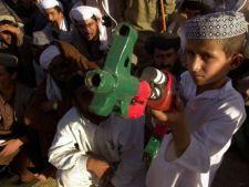 Copiii afgani, momiti cu bomboane sa devina luptatori-kamikaze
