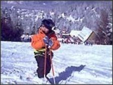 predeal copil cu schiuri